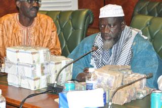 President SIC Momodou Lamin Touray with stash of Cash