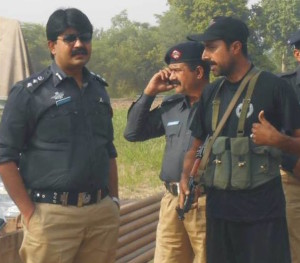 District Police Officer Chiniot Muhammad Abdul Qadir Qamar inspects security arrangements for the conference.