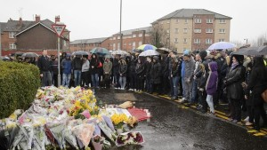 """A vigil is held outside the shop where Asad Shah worked in Glasgow, Saturday March 26, 2016. Scottish police say the killing of a Muslim shopkeeper who wished Christians a happy Easter is being investigated as """"religiously prejudiced."""" Vigils were held Friday and Saturday in memory of 40-year-old Asad Shah, who was killed Thursday night in Glasgow. (John Linton/PA via AP) UNITED KINGDOM OUT NO SALES NO ARCHIVE"""