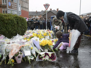 "Kyonka and Marika O'Neil leave flowers in tribute to Asad Shah outside his shop in Shawlands, Glasgow, as a second vigil has been held for the well-respected Muslim shopkeeper who was killed in what police are treating as a ""religiously prejudiced"" attack. PRESS ASSOCIATION Photo. Picture date: Saturday March 26, 2016. Mr Shah was found seriously injured outside his shop in Minard Road in the Shawlands area of Glasgow on Thursday night and pronounced dead on arrival at hospital. See PA story POLICE Shopkeeper. Photo credit should read: John Linton/PA Wire"
